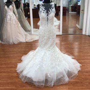Ivory wedding gown with lace floral print